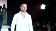 Models on the catwalk in formal wear video
