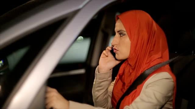 Modern Arab woman using mobile phone in the car video