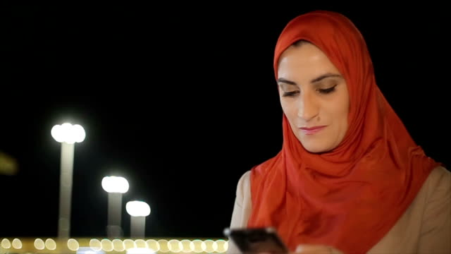 Modern Arab woman with mobile phone video