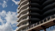 Modern building with apartments against the blue sky video