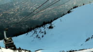 Modern cable car lifting tourists to skiing run, mountain resort video