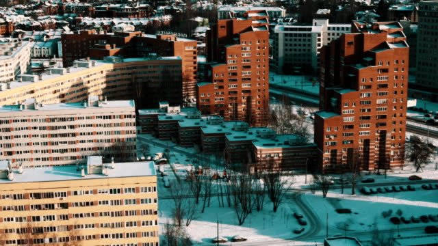Modern city dormitory area living houses covered in snow on sunny winter day video
