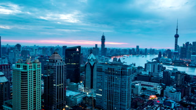 modern cityscape and skyline Shanghai from night to day,timelapse. video