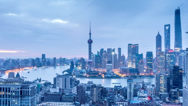 modern cityscape, skyline of Shanghai from night to day,timelapse. video