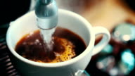 Modern coffee maker makes a cup of strong black coffee video