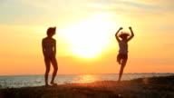 Modern contemporary dance young gymnast women at sunset beach video