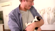 Modern Dad Holding Cat on his arms and smiles video