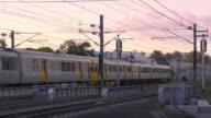 A modern electric passenger train at sunset video