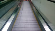 Modern escalator moving up at business, shopping center, airport video