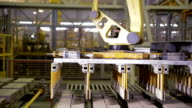 Modern factory equipment. Robots working at industrial factory video