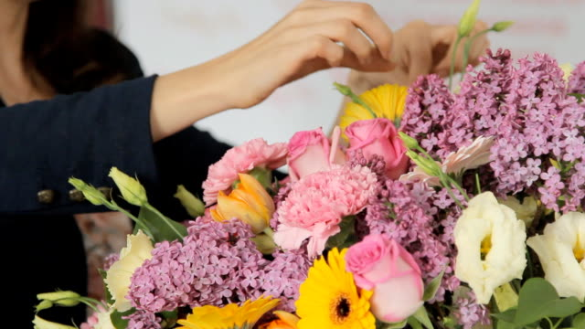 Modern florist makes a bouquet to decorate the hall before holidays video