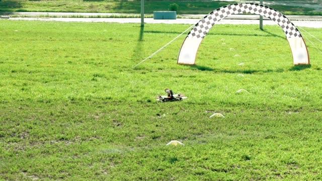 Modern FPV drones flying over grass field video