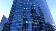 Modern glassy skyscraper zoom in establishing shot, FullHD video