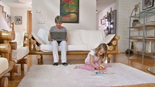 HD DOLLY: Modern Grandmother And Playful Granddaughter video