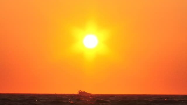 modern high-speed boat and fantastic sunset video