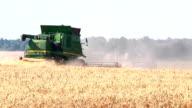 Khmelnitskiy, Ukraine - July 23: Modern John Deere combine harvesting grain in the field near the town Khmelnitskiy, Western Ukraine July 23, 2015 video