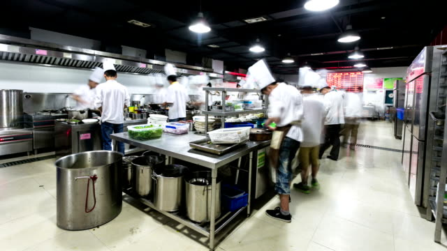 modern kitchen and busy chefs, time lapse. video