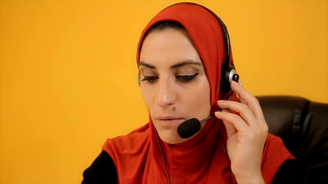 Modern muslim woman working in call centre video