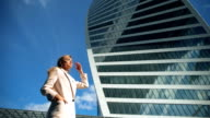 Modern skyscrapers and portrait of young attractive businesswoman video
