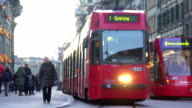 Modern streetcar carrying passengers in old European city, public transport video
