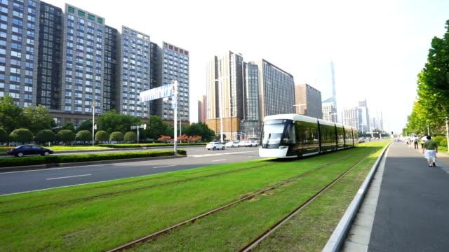 modern streetcar running in midtown of modern city video