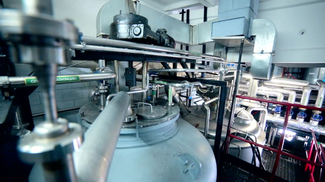 Modern technological industrial equipment. Pipelines, pumps, filters, gauges, sensors, motors. tank at chemical industrial factory video