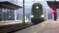 Modern train arriving at railway station, transportation services industry video