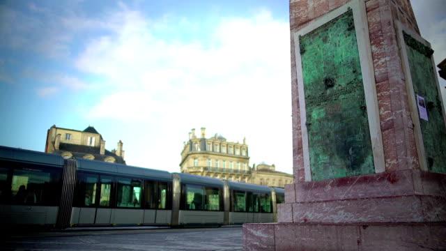 Modern trolley car arriving at square Place de la Victorie in Bordeaux, France video