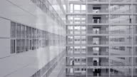 Office workers walking on elevated walkway, Ice Palace, The Hague video