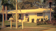 TUCSON, ARIZONA 1975: Modest Arizona home with big cactus in front yard. video