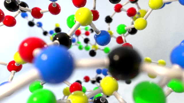 Molecule ball and stick model fly through atoms chemistry biology science tech video