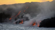 Molten Lava Causing Steam Ocean Waves Sunset video