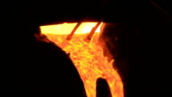 Molten metal starts to flow from the furnace video