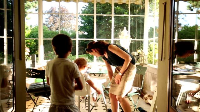 Mom and baby together at home beautiful balcony during sunset time video