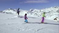 TS Mom and dad teaching their daughter skiing video