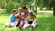 Mom and dad with three kids video