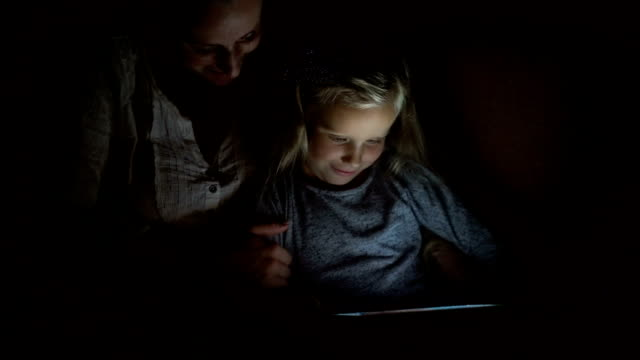 Mom and daughter at dusk looks hilarious film video