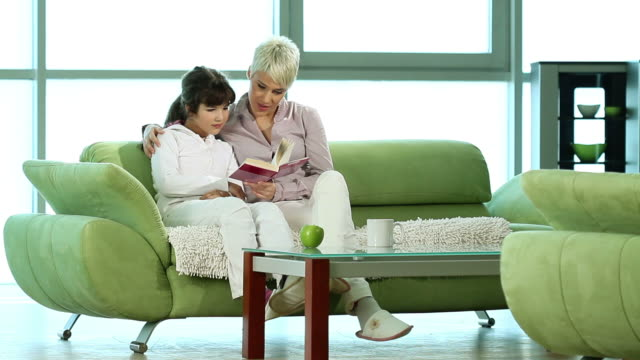 Mom and daughter reading a book. video