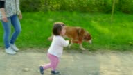 Mom And Daughter Smiling With Dog Pet Leisure In Park video