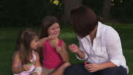 Mom and girls with bubbles video