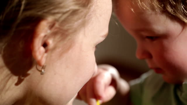 Mom and her son kissing. video