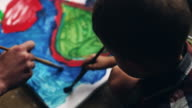 Mom and kid boy painting video
