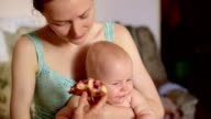 Mom and little son eating cherry pie video