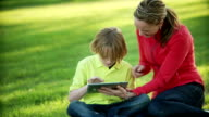 Mom and son use a tablet video