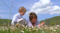 Mom and the little boy in a field video