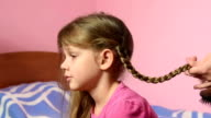 Mom braided pigtail daughter and kissed her on the cheek video