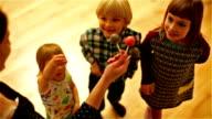 Mom gives children lollipops video