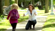 Mom greets daughter coming home from school video