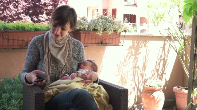 Mom Mother Holding Baby Child Teleworking Telework Telecommuting Remote Work video
