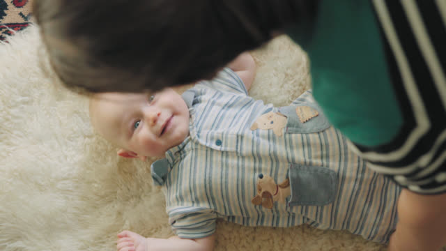Mom Puts Smiling Baby Down video